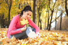 Young woman in the autumn park Royalty Free Stock Images