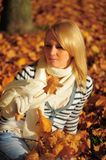 Young woman  in autumn park Stock Photography