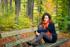 Young woman in autumn park. Portrait of young woman in autumn park Royalty Free Stock Image