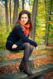 Young woman in autumn park. Portrait of young woman in autumn park Stock Photo