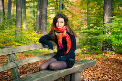 Young woman in autumn park. Portrait of young woman in autumn park Stock Images