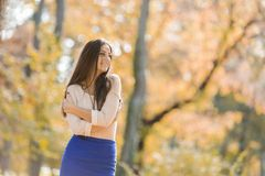 Young woman at autumn park Stock Photography