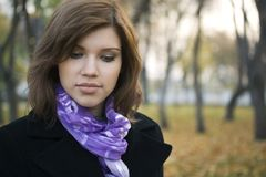 Sad young fashion woman walking in autumn park Royalty Free Stock Photography
