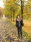 Young Woman in Autumn Park Stock Photo