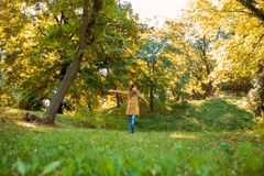 Young woman in autumn park. Young happy woman in autumn park royalty free stock image