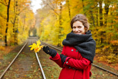 Young woman in autumn park Stock Image