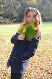Young woman in autumn park. Young happy woman in autumn park with leaves Stock Images