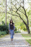 Young woman in the autumn park Stock Image