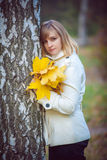 Young woman in an autumn park Royalty Free Stock Photo