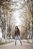 Young woman at autumn park Royalty Free Stock Photo