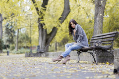 Young woman at autumn park Royalty Free Stock Photos