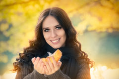 Young Woman Autumn Portrait. Pretty girl in the park, with autumn foliage royalty free stock images
