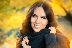 Young Woman Autumn Portrait. Pretty girl in the park, with autumn foliage royalty free stock photos
