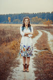 Young woman on the autumn road Royalty Free Stock Photos