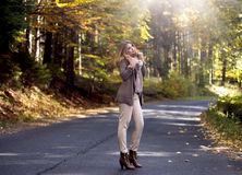 Young woman in autumn staying on street Royalty Free Stock Photos