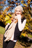 Young woman in autumn sunshine outdoor Stock Image