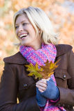 Young woman on autumn walk Royalty Free Stock Photo