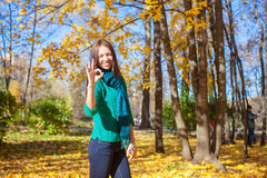 Young woman in autumn yellow park Stock Photo