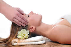 Young woman aving a facial massage Stock Images