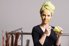 Young woman with an avocado facial mask Royalty Free Stock Photography