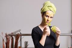 Young woman with an avocado facial mask Stock Photos