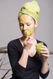 Young woman with an avocado facial mask Stock Photo