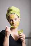 Young woman with an avocado facial mask Royalty Free Stock Image