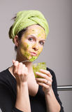 Young woman with an avocado facial mask Stock Images