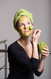 Young woman with an avocado facial mask Royalty Free Stock Images