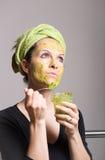 Young woman with an avocado facial mask Stock Image