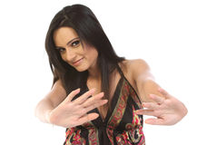 Young woman in avoiding gesture. Young woman sitting in avoiding gesture Royalty Free Stock Photo