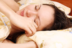 Young woman awaking Royalty Free Stock Images