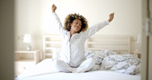 Young Woman Awaking On The Bed Stock Image