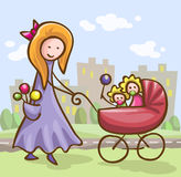 Young woman with a baby carriage Royalty Free Stock Photography