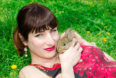 Young woman with baby rabbit Royalty Free Stock Photos