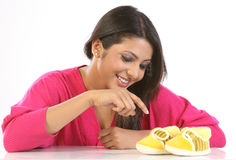Young woman  with baby shoes Stock Photo