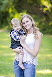 Young woman and baby Royalty Free Stock Photography