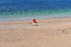 Young woman with baby stroller on the beach. Montenegro Stock Image