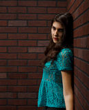 Young woman with back against the wall Royalty Free Stock Photo