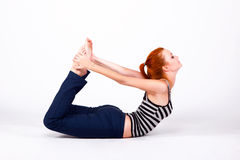 Young woman in back bends pose Royalty Free Stock Photos