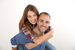 Young woman on the back of her boyfriend isolated Royalty Free Stock Image