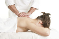 Young woman back massage spa Stock Images