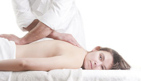 Young woman back massage spa Royalty Free Stock Image