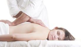 Young woman back massage spa. Young beatiful young woman receiving back massage at spa Royalty Free Stock Image