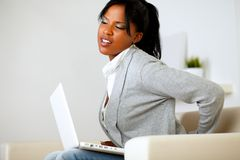 Young woman with back pain Stock Photos