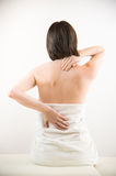 Young woman with backache Stock Photography