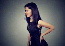 Young woman with backache pain. Young sad woman with backache pain Royalty Free Stock Photo