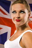 Young woman on the background with british national flag Stock Image