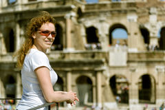 Young woman on the background of the Colosseum in Rome Stock Images