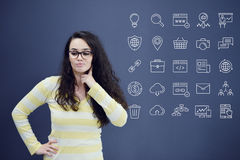 Young woman with background with drawn business chart, arrow and icons. Successful business concept Stock Image